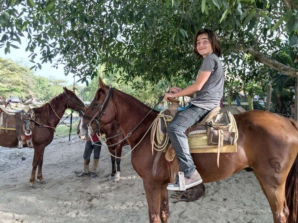 a teenager on horseback