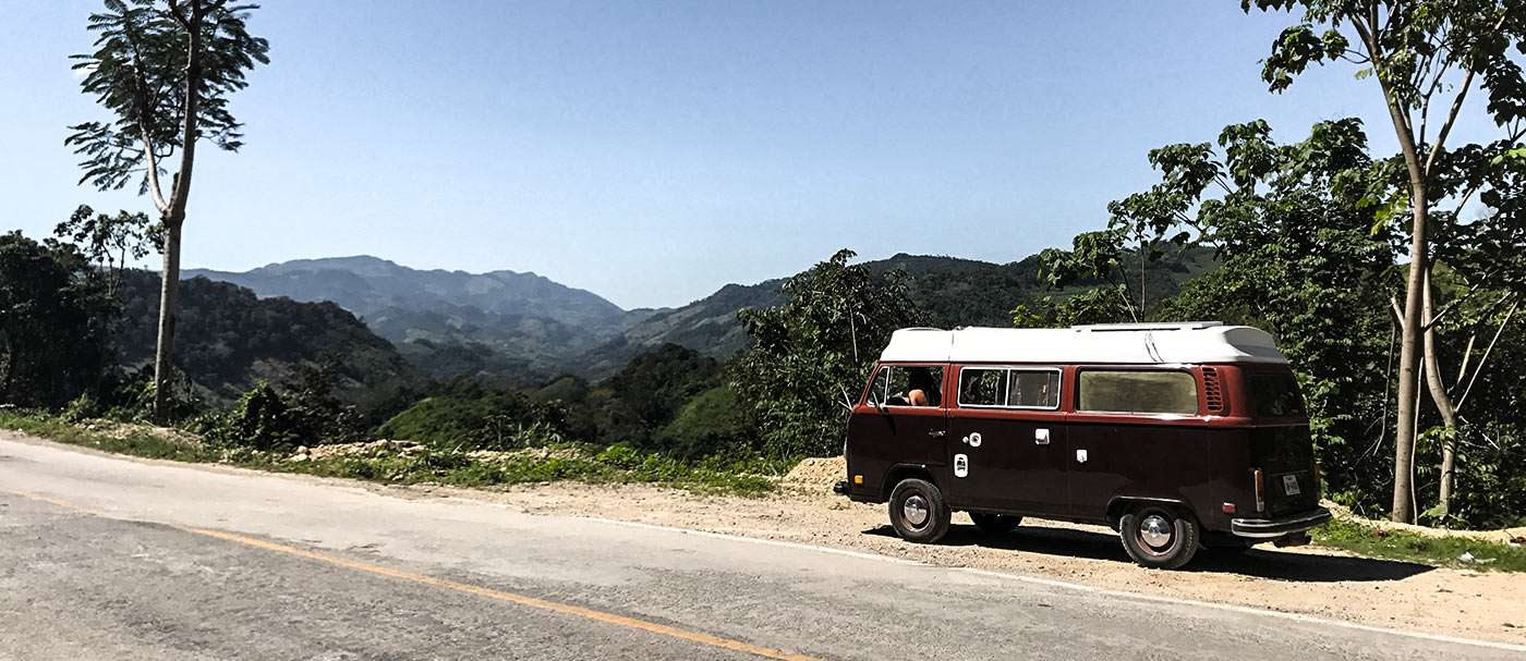 a 1978 Champagne Edition Volkswagen Bus with the ASI Riviera Conversion Camper parked along a highway near Palenque, Mexico