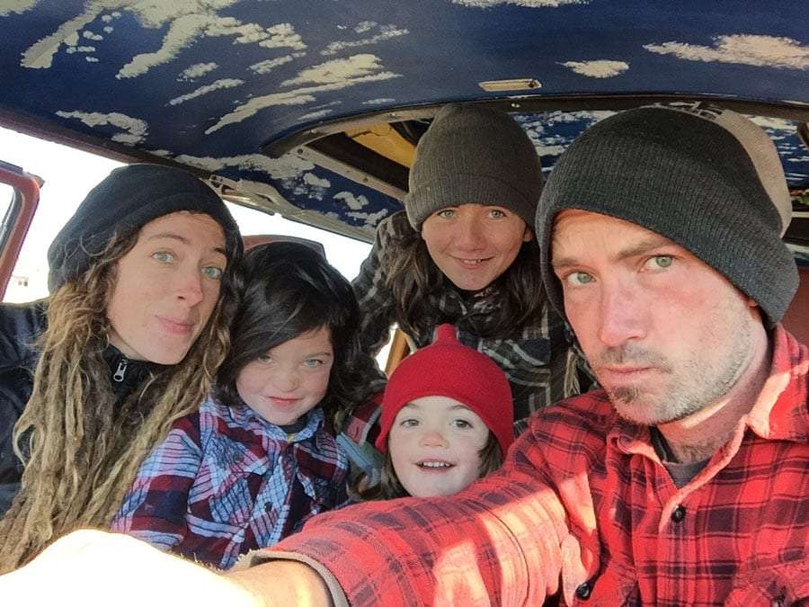 a family of five crammed into a VW Bus