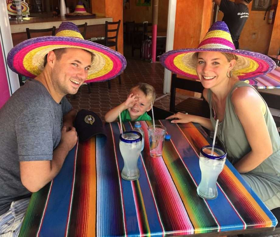 a family in sombreros at a mexican restaurant