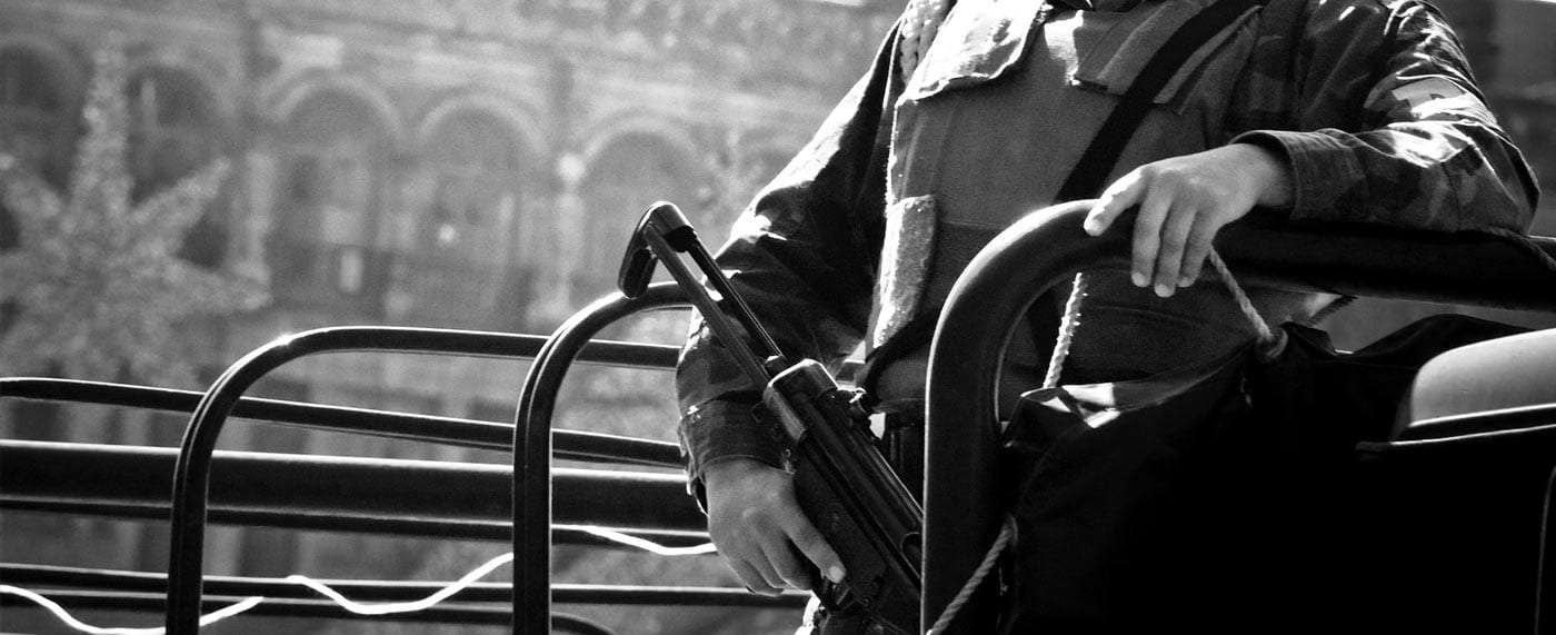 policeman in mexico holding an automatic rifle
