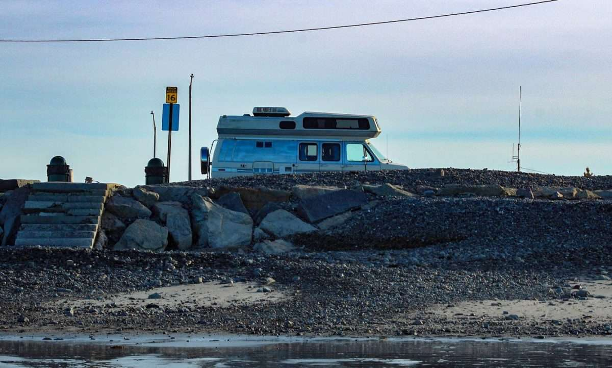 a van parked near a body of water