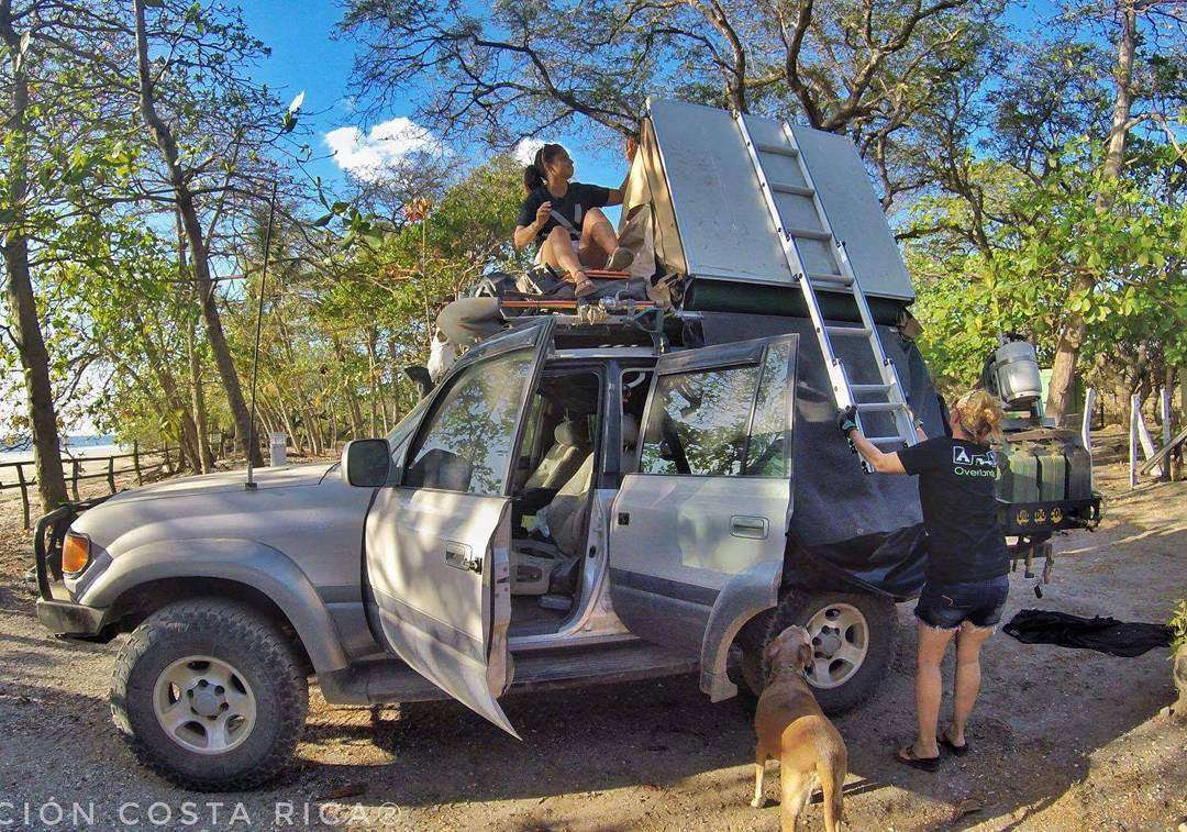 two women, a dog, a rooftop tent and a landcruiser, somewhere in central america