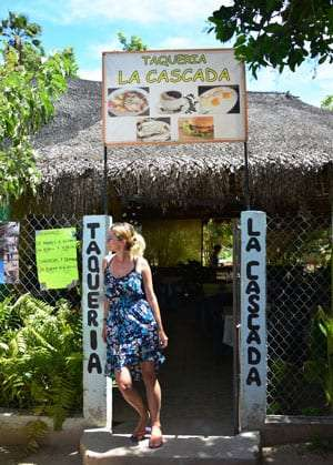 Emma stands outside of a palapa taqueria