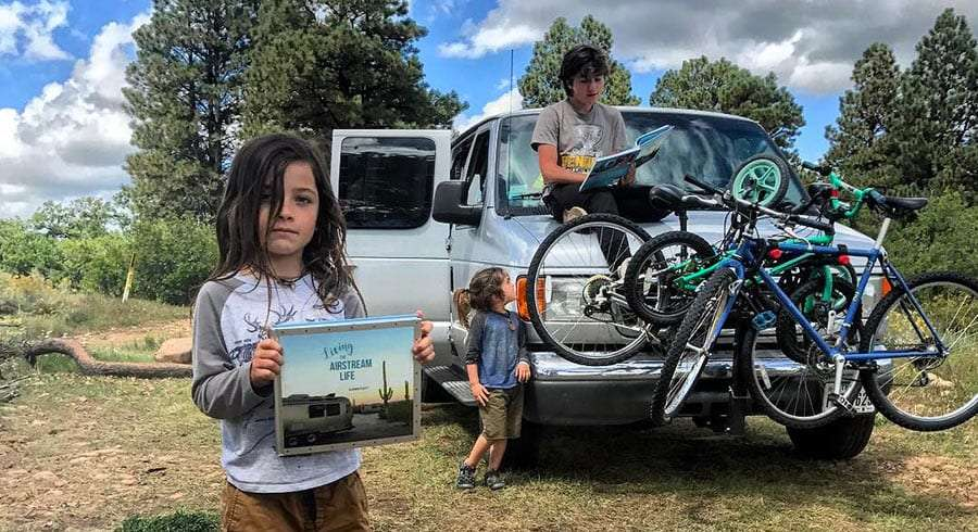 my kids holding the living the airstream life book