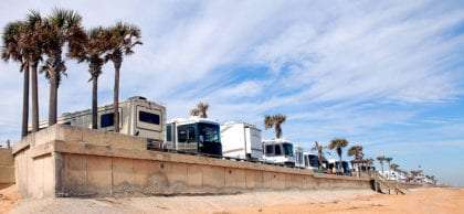 RVs lined up in a row against a beach in Florida