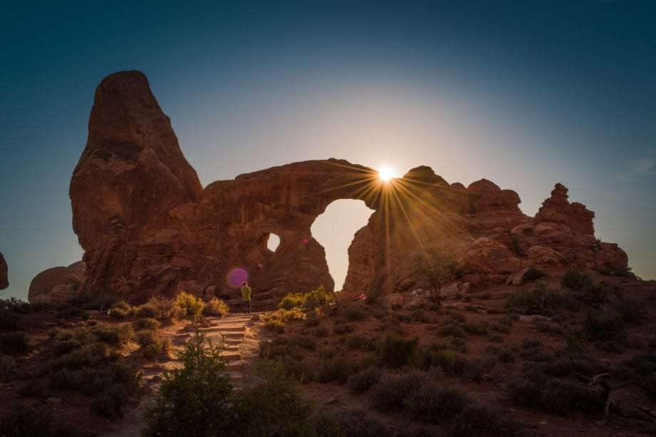 sunrise over an arch