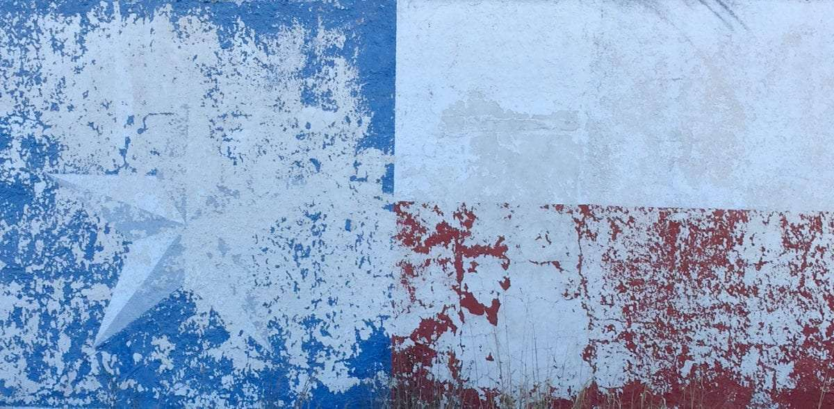 texas' flag painted on the side of a barn