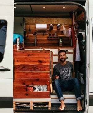 A man sitting in a conversion van.
