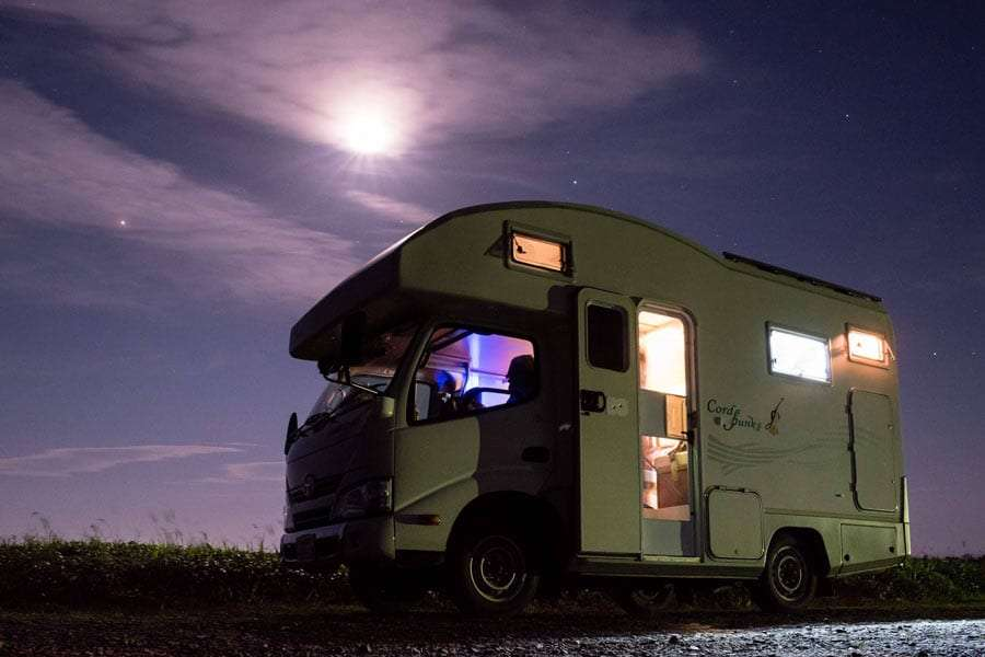 an RV boondocking beneath the night sky