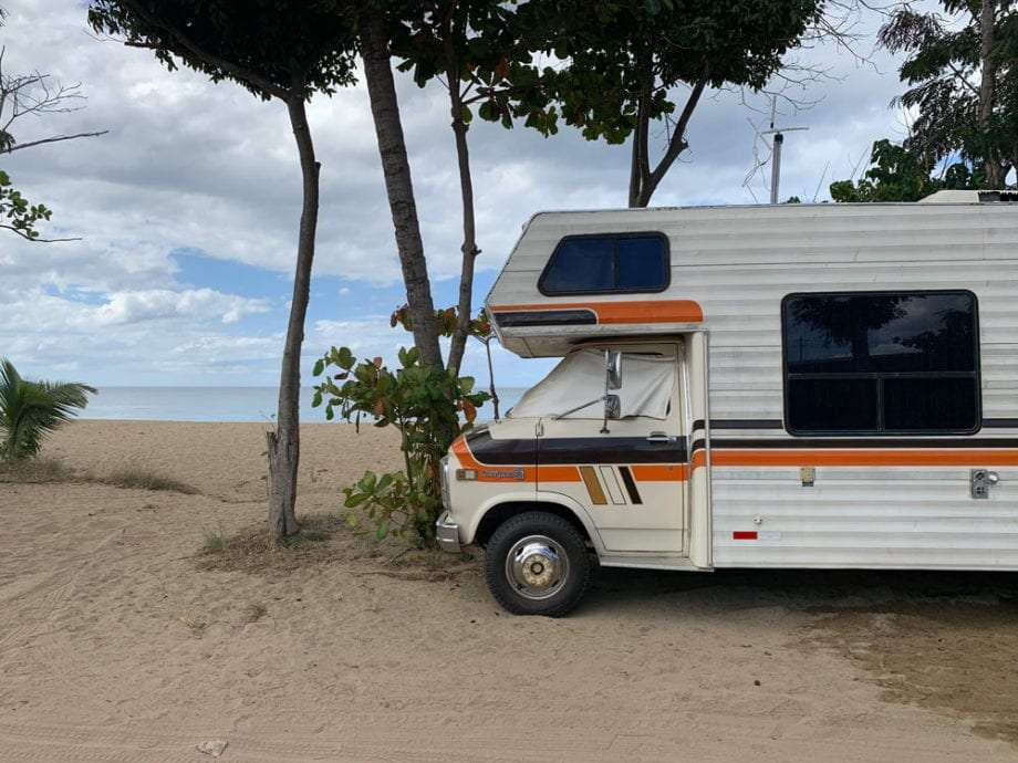 An RV parked on the beach in Rincón, Puerto Rico.