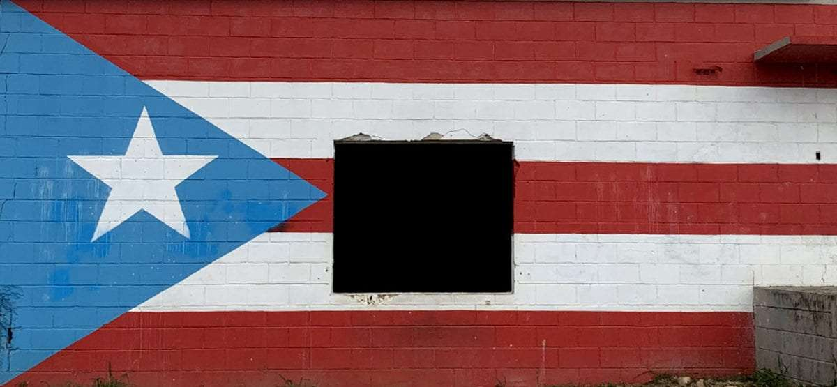 the puerto rican flag painted on an old concrete building