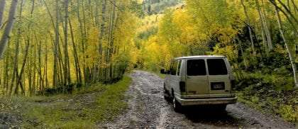 a van drives through the san juan mountains