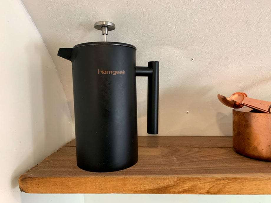 a black, metal french press