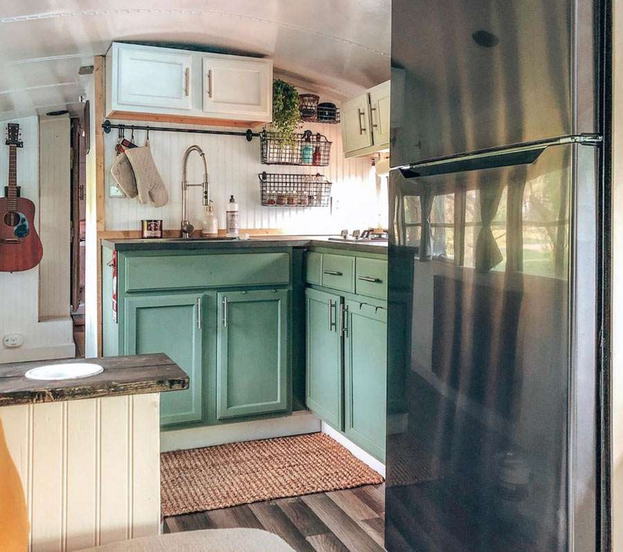 a small but beautiful kitchen in a converted school bus