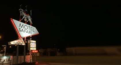 a lighted sign reads Motel Safari
