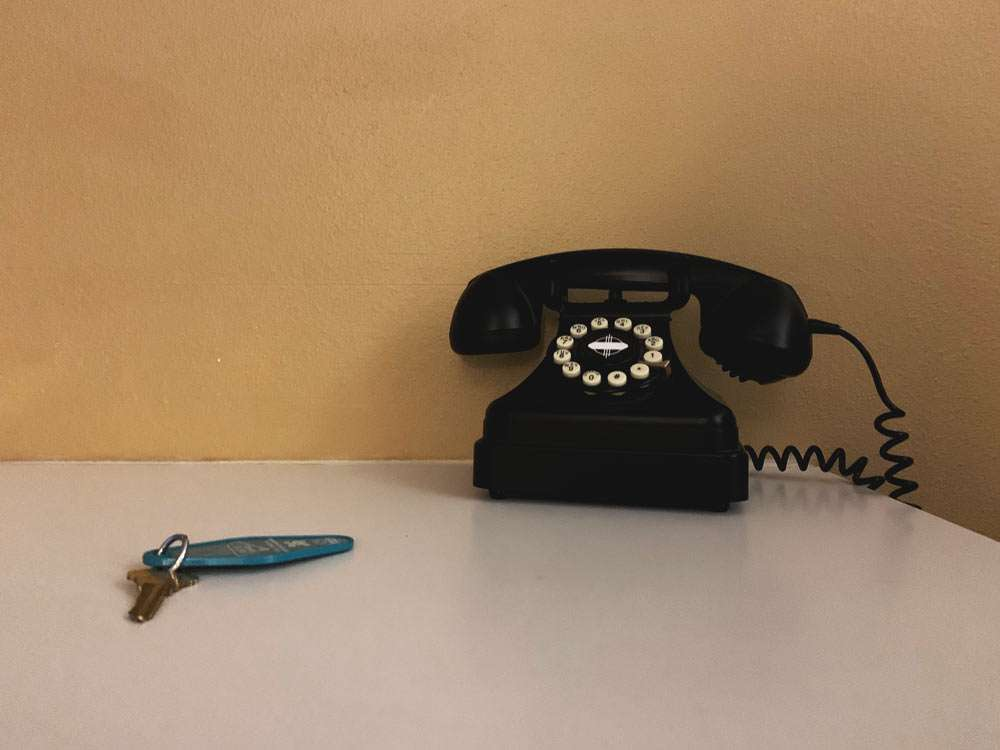 an old motel key and telephone