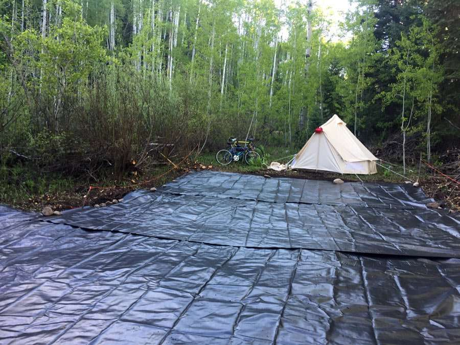 geotextile fabric strewn across a driveway prep