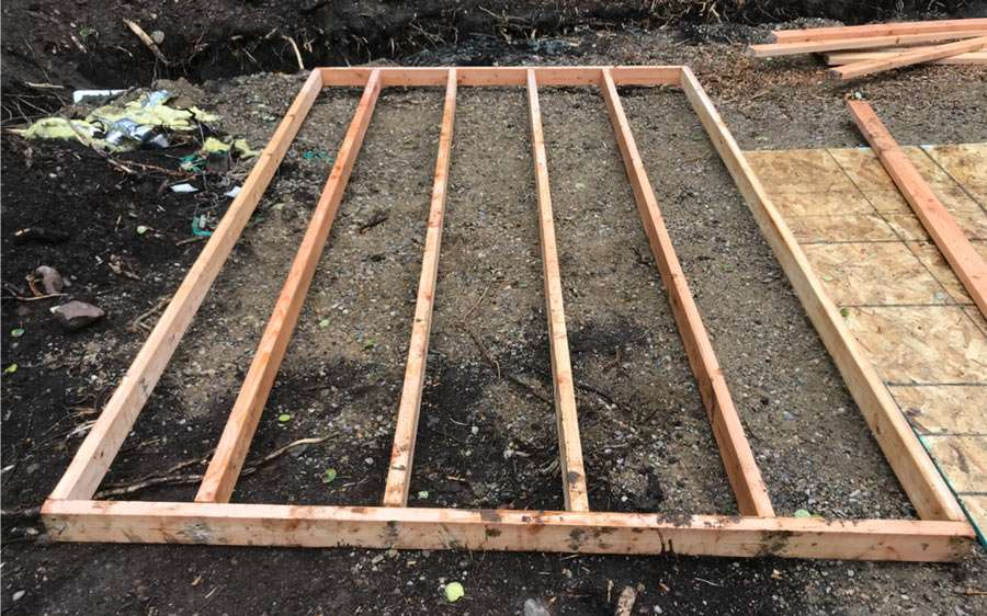 a 2x4 wall being constructed on the ground