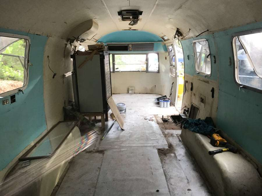 The Airstream, walls ripped out, still a before in progress.