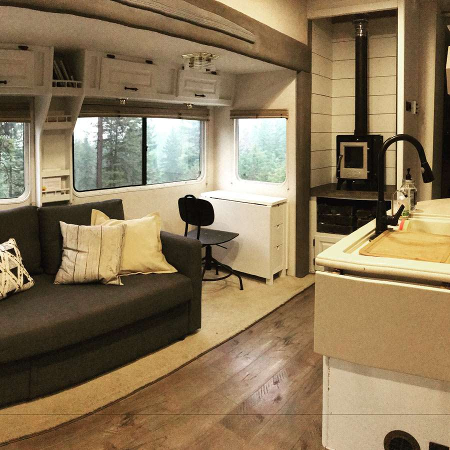inside of a renovated fifth wheel, complete with woodstove