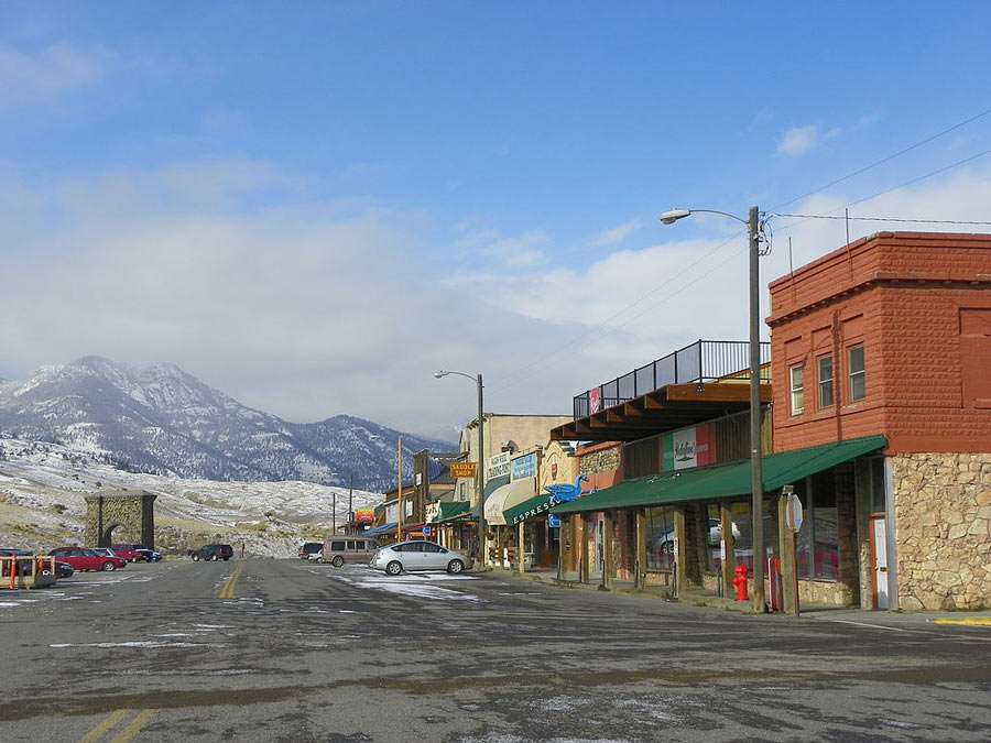 a sleepy wild west town, mountains in the distance