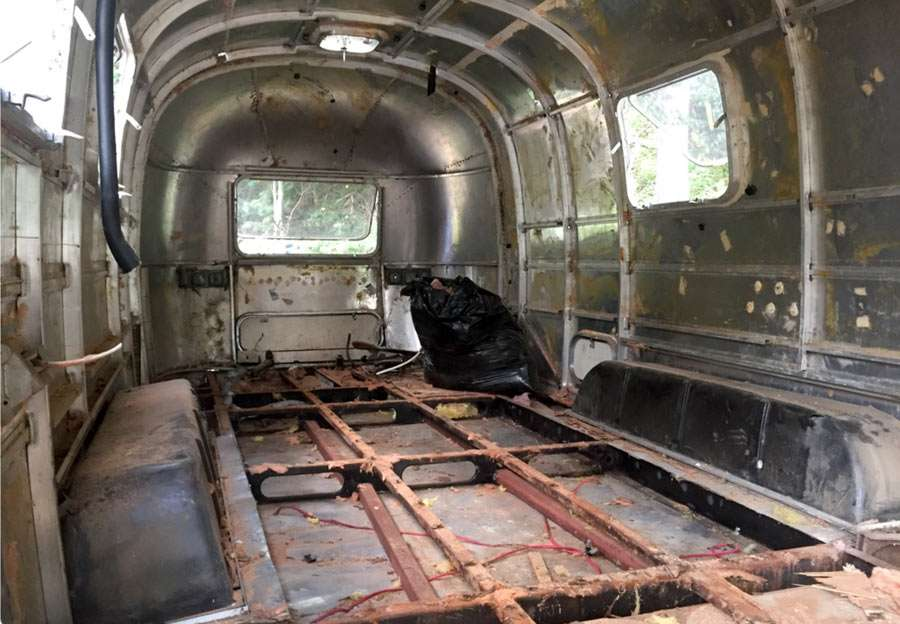 the empty shell of a gutted Airstream