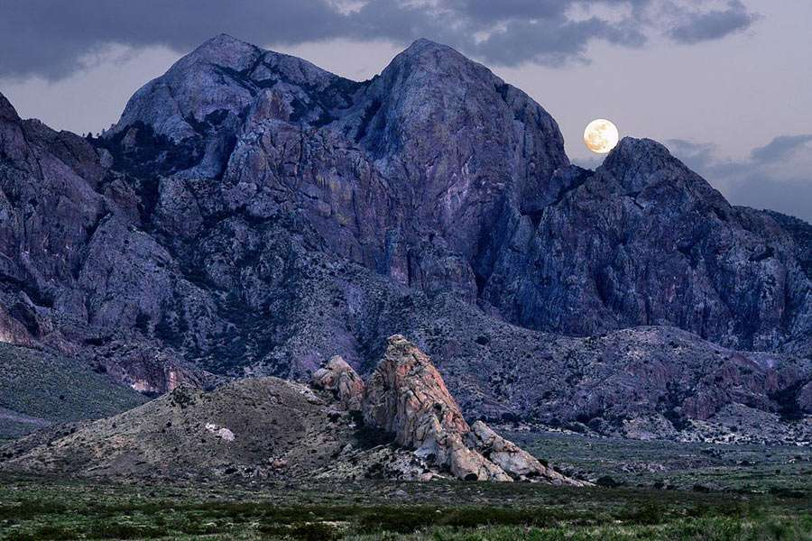 full moon rising stunningly over purple mountains majesty