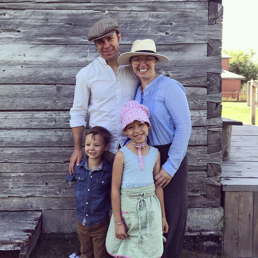 all four of the Peterson family, dressed in 1800s clothing