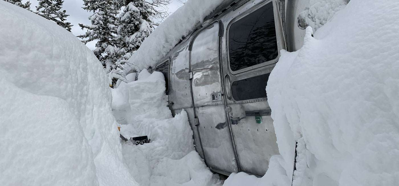 an airstream, deep in the snow