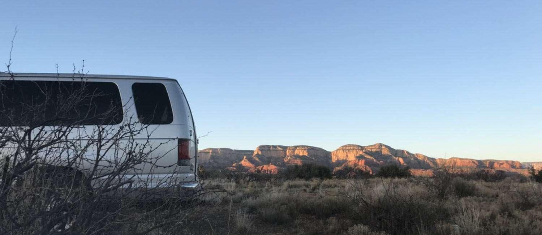 a van camping in a desert paradise