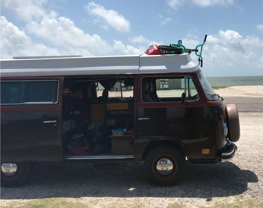 a VW Bus camping on the shores of padre island