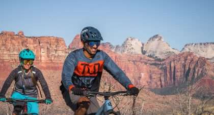 the author and her partner biking through a colorful canyon in Hurricane, Utah