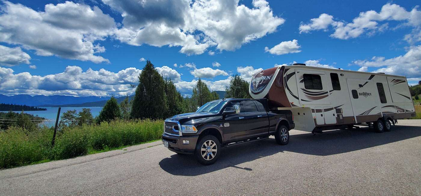 a large truck pulls an even larger RV!