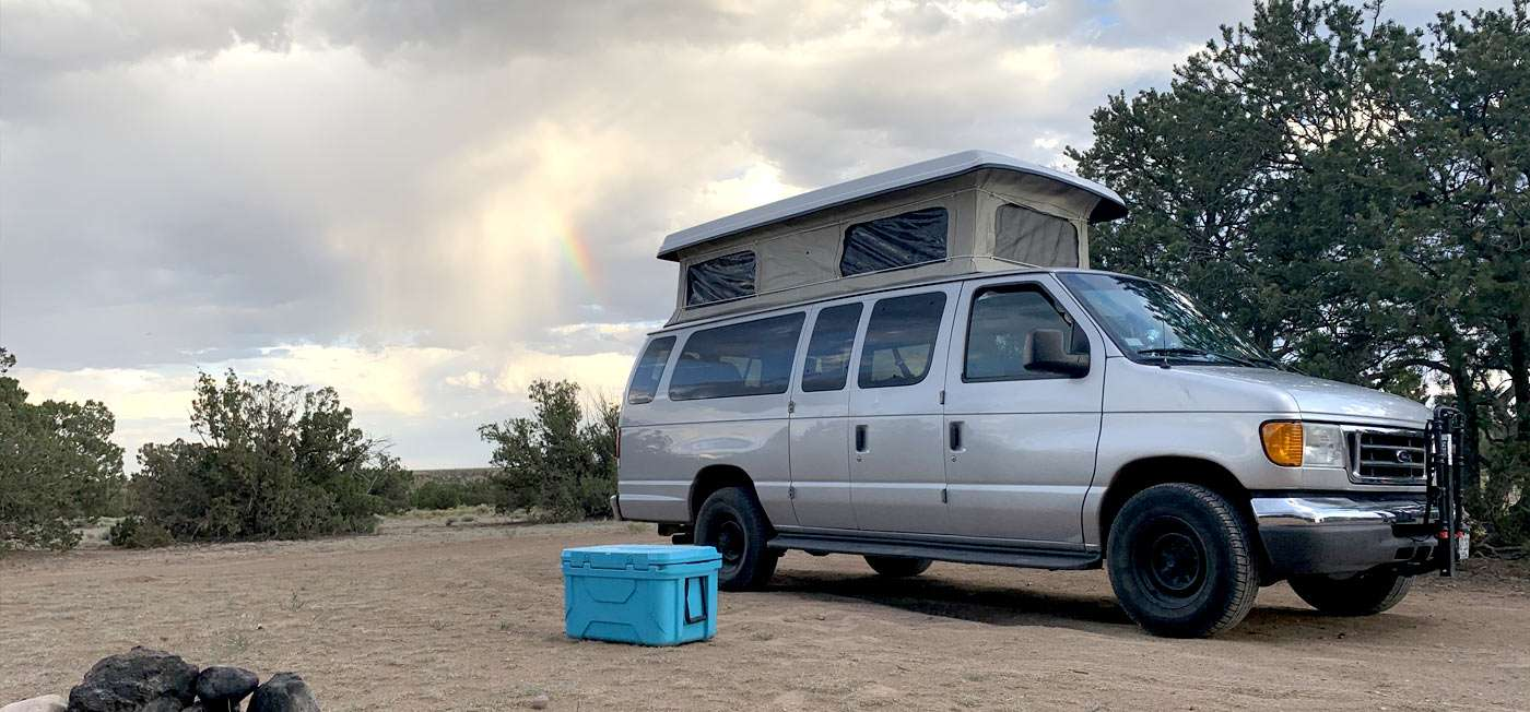 a Ford van soaking up the sun in a New Mexican desert