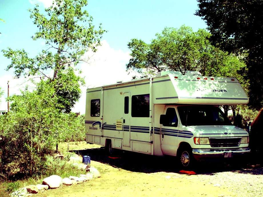 a Class C RV parked in Taos, NM RV Park