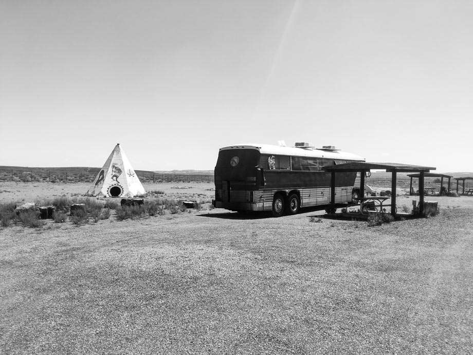 an RV camping off the grid near a teepee in Arizona