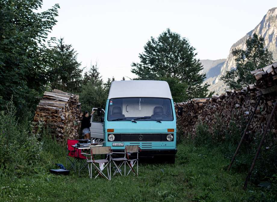 a Volkswagen LT campervan camping in the forested mountains of Europe