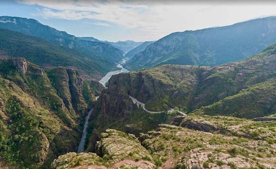 a river cuts a gorge through France's mountains