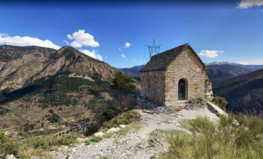 a stone building atop a mountain