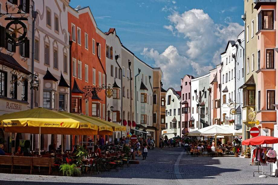 colorful homes line a pedestrian street through an Austrian village