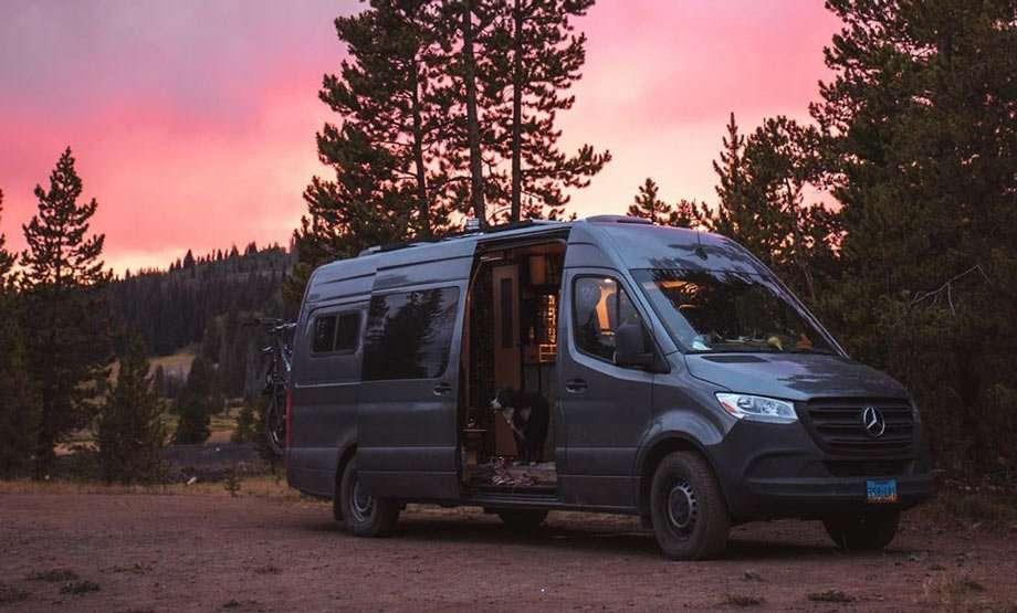 a modern van beneath a violet sky