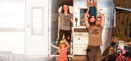 a family in front of their previous home, a shiny silver trailer, two children, mom and dad, being cute, funny and lovely all at once