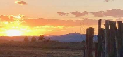 sunset over New Mexico, an old wooden fence