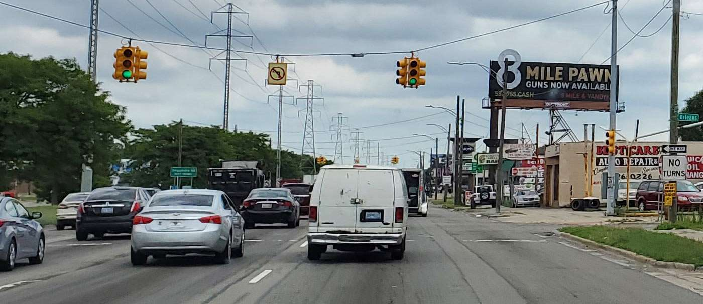 vehicles drive down 8 Mile Road in Detroit, USA
