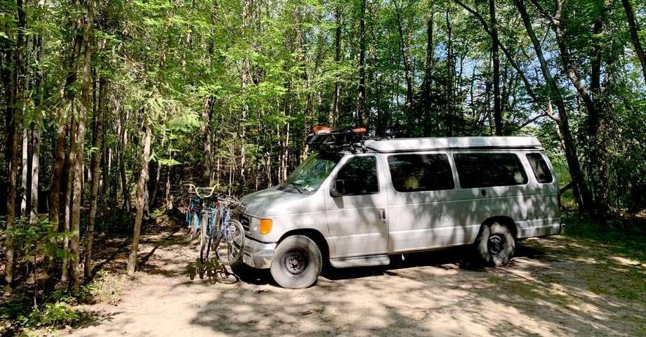 a van preparing to camp at woodenfrog campground