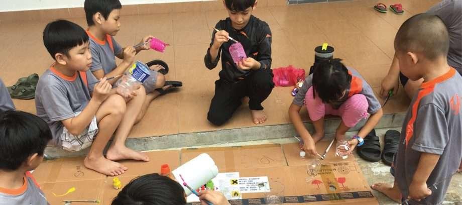 a group of children making art