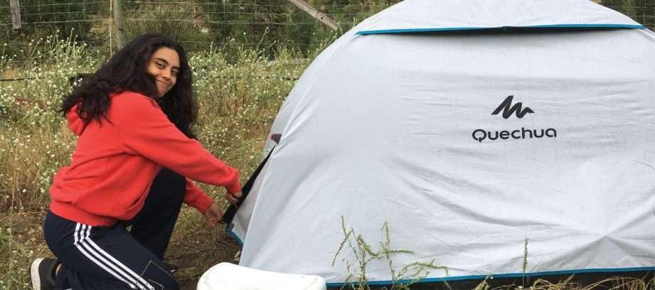a woman entering a tent