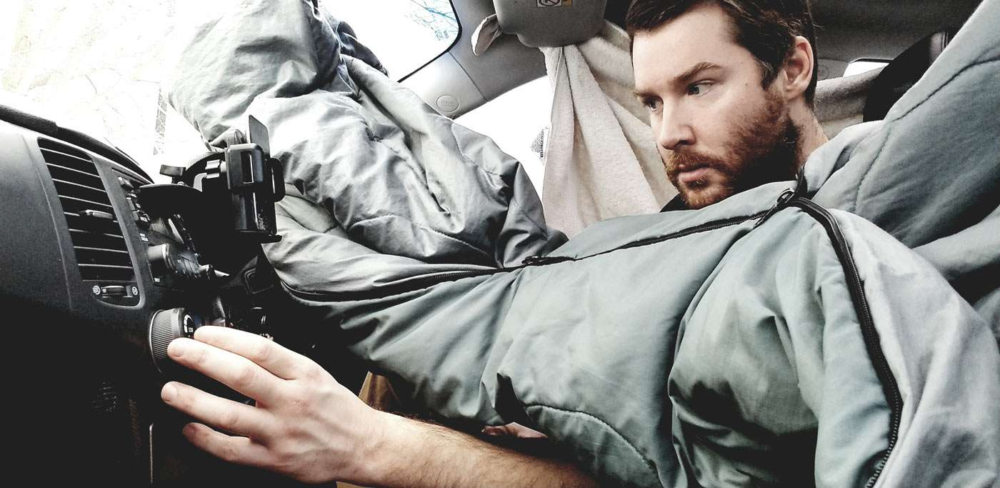 adjusting the dials on the dashboard heater, a man and his sleeping bag brave the northern canadian winter