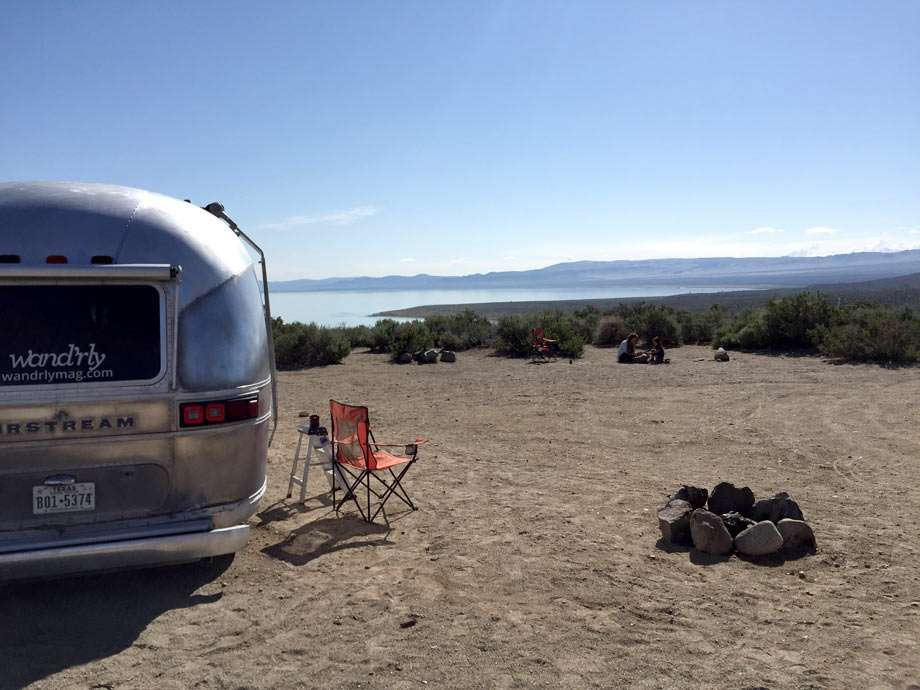 a vintage Airstream camping near a lake outside of Lee Vining, California